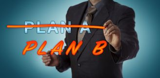 Manager Striking Out PLAN A To Activate PLAN B. Unrecognizable manager crossing out PLAN A with a felt tip pen to replace it with PLAN B. Business concept for stock image