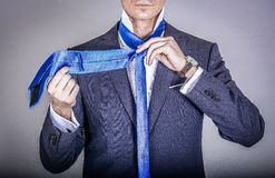 Manager in suit getting dressed Stock Images