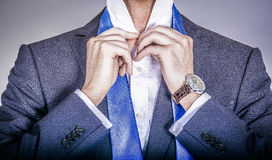 Manager in suit getting dressed Royalty Free Stock Image