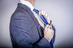 Manager in suit getting dressed Royalty Free Stock Photography