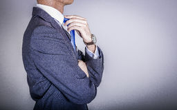Manager in suit getting dressed Stock Image
