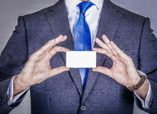 Manager in suit holding a business card Royalty Free Stock Images