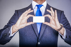 Manager in suit holding a business card Stock Image