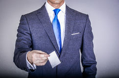 Manager in suit holding a business card Stock Photography