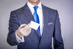 Manager in suit holding a business card Royalty Free Stock Image