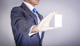 Manager in suit holding a business card Royalty Free Stock Photography