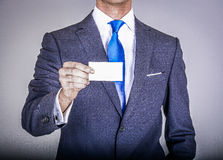 Manager in suit holding a business card Royalty Free Stock Photo