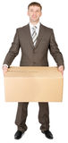 Manager in suit holding parcel box Royalty Free Stock Photos