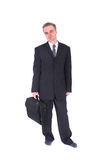Manager and suitcase Royalty Free Stock Images