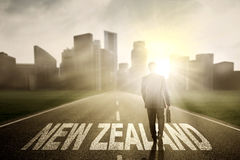 Manager with suitcase and New Zealand word Royalty Free Stock Photo
