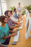 Manager supervising work in call center Royalty Free Stock Photo