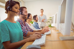 Manager supervising work in call center Stock Photo