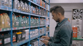 Manager With Tablet PC Checking Goods At Car Supermarket Warehouse shop stock video footage