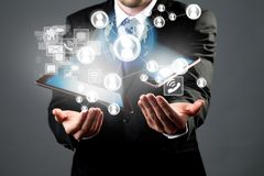 Manager with tablet and smart phone Royalty Free Stock Photos