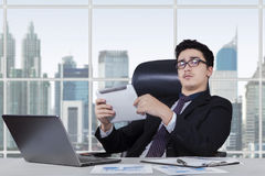 Manager with tablet at workplace Stock Images