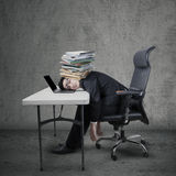 Manager take a rest at desk. Exhausted young entrepreneur sleeping on laptop computer at table Stock Photos