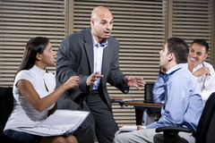 Manager talking with group of office workers Stock Images