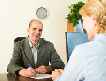 Manager talking with a pensioner Stock Photo