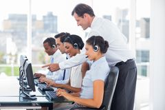 Manager talking to his employees. Into a call centre Royalty Free Stock Images