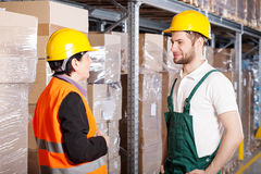 Manager talking with worker Stock Photography