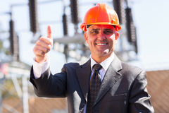 Manager thumb up. Portrait of happy middle aged male industrial manager giving thumb up at substation Royalty Free Stock Images