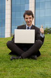 Manager thumbup. Succesful manager with notebook thumb up Stock Photos