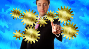 Manager Touching Gear Train Made Of Eight Workers Royalty Free Stock Images