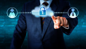 Manager Touching Locked Cloud Linked To Workers Royalty Free Stock Photography