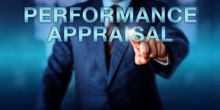 Manager Touching PERFORMANCE APPRAISAL Onscreen. Manager is touching PERFORMANCE APPRAISAL onscreen. Business concept for job performance review or evaluation Stock Photo