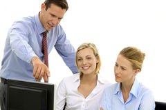 Manager training employees to use computer Stock Photos