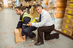 Manager training worker for health and safety measure. In a large warehouse Royalty Free Stock Photo