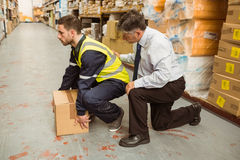 Manager training worker for health and safety measure. In a large warehouse Stock Photography