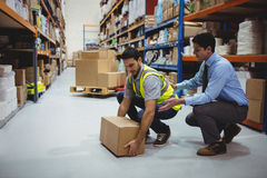 Manager training worker for health and safety measure. In a large warehouse Royalty Free Stock Image