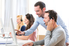 Manager training a young attractive people on computer Stock Photos