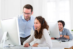 Manager training young attractive people Royalty Free Stock Image