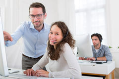 Manager training young attractive people Royalty Free Stock Photography
