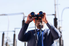 Manager using binoculars Stock Photography