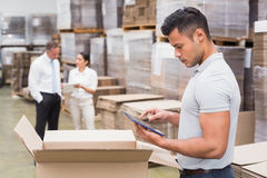 Manager using digital tablet in warehouse. Portrait of male manager using digital tablet in warehouse Stock Image