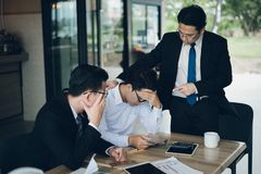 Manager is very angry for Reported sales decrease and he shouted to employee, employee is stressed stock images