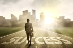Manager walking on the road to success Royalty Free Stock Image
