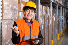 Manager in warehouse Royalty Free Stock Photos