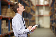 Manager In Warehouse With Clipboard Stock Photos
