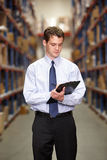 Manager In Warehouse With Clipboard royalty free stock photo