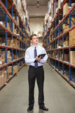 Manager In Warehouse With Clipboard Royalty Free Stock Images