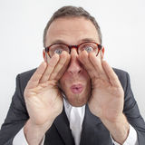 Manager whispering, shouting management strategies with hands like loud-hailer Stock Photography