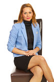 Manager woman on chair Stock Images