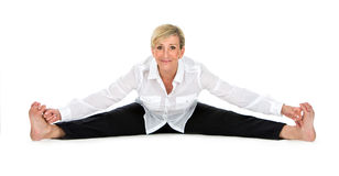 Manager woman doing yoga at white background Royalty Free Stock Photography