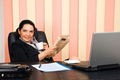 Manager woman  holding coffee and newspaper Stock Photos