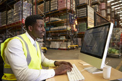 Manager at work in the on-site office of a warehouse Royalty Free Stock Photo