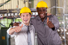 Manager and worker. Factory manager and worker thumbs up Royalty Free Stock Photos